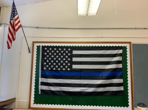 A local school district forced a middle school teacher to take down a pro-police flag from her classroom wall. Yet the district allows Black Lives Matter and LGBT messages to be displayed. (Photo: Submitted by Chris Sutherland)