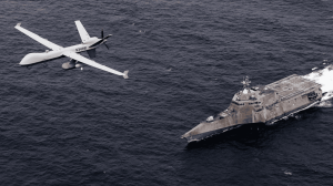 An MQ-9 SeaGuardian unmanned maritime surveillance aircraft system flies over Independence-variant littoral combat ship USS Coronado (LCS 4) during U.S. Pacific Fleet's Unmanned Systems Integrated Battle Problem 21. (U.S. Navy photo by Chief Mass Communication Specialist Shannon Renfroe)
