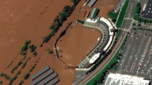 An after photo shows New Jersey baseball park completely wiped out by floodwater. Pic: AP/MAXAR