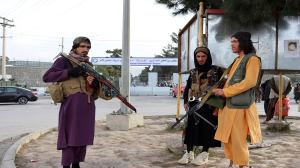 Taliban fighters stand guard in front of the Hamid Karzai International Airport after the U.S. withdrawal in Kabul, Afghanistan, on Tuesday. (AP)